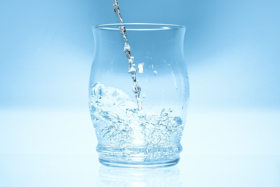 Glass Mirroring Blue Water High Jumping Drops